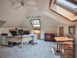 We took a rough attic and created a home office by insulating, installing board and plaster and adding skylights. This became a wonderful home work space.